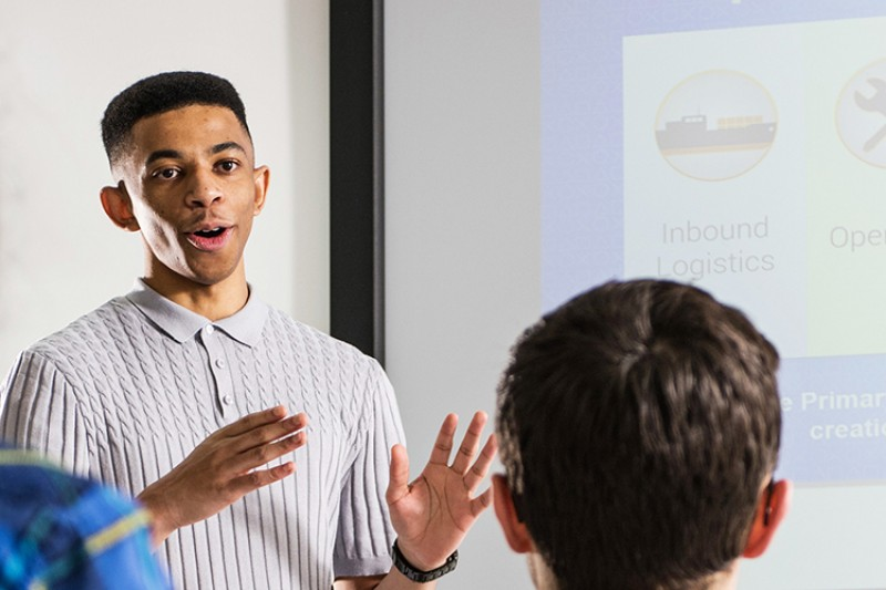 A student delivering a presentation