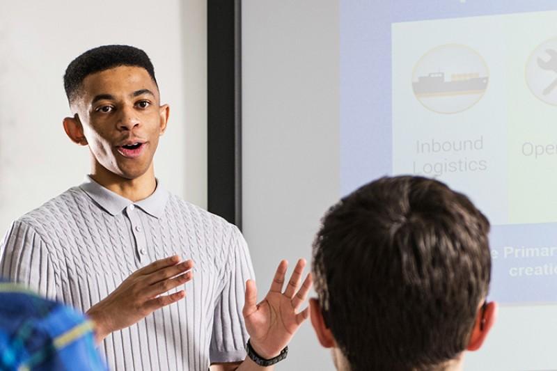 A student delivering a presentation