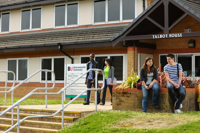 students sitting outside talbot house