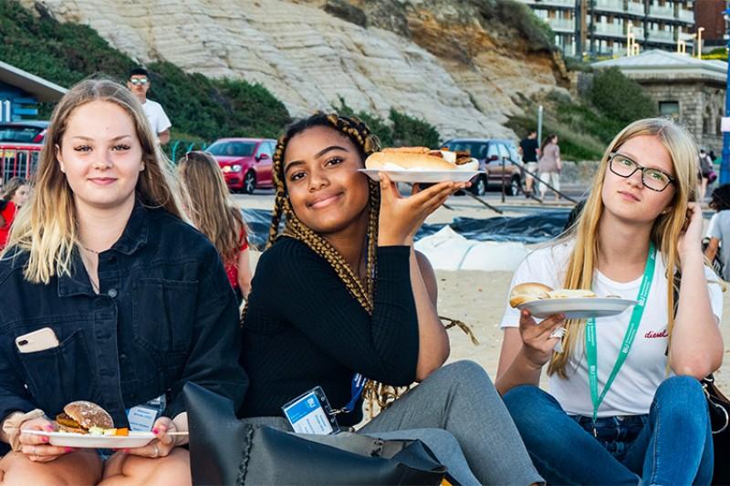 Teenagers sitting on the beach