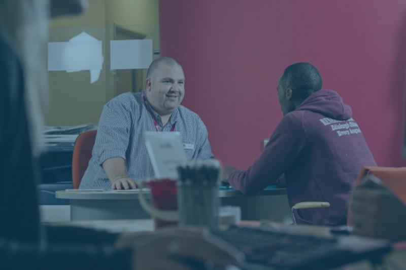 An AskBU team member talking to a student