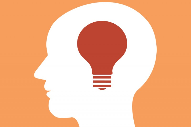 A graphic of a lightbulb in a head