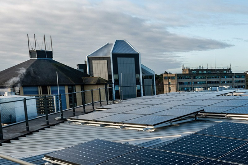 On top of the Fusion Building, with a view of the solar panels and the rest of campus in the background