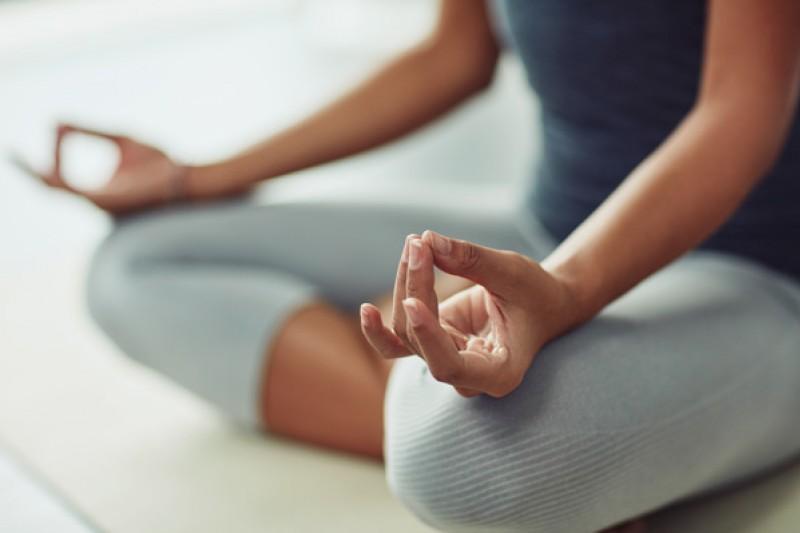 A woman pulling a yoga pose
