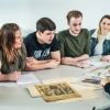 History students looking at old newspapers