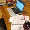 A laptop and notes on a kitchen table