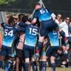 TeamBU football team celebrating