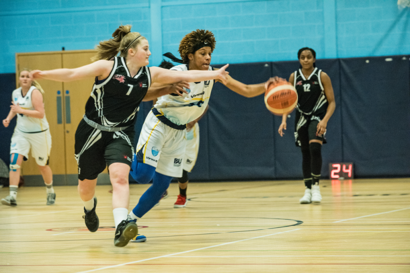 Woman competing in a basketball match