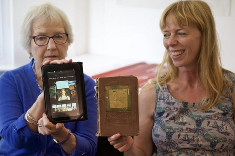 Barbara and Jenni Creswell reading Anne of Green Gables in both print and e-book format