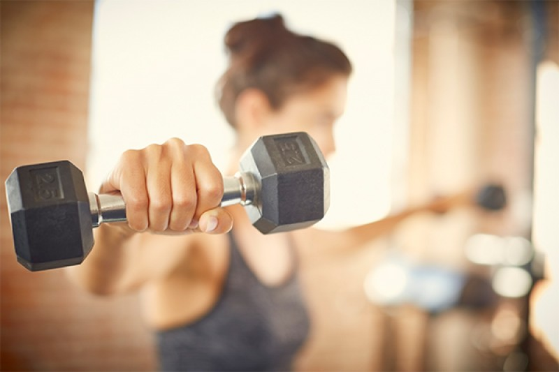 Image of person using weights
