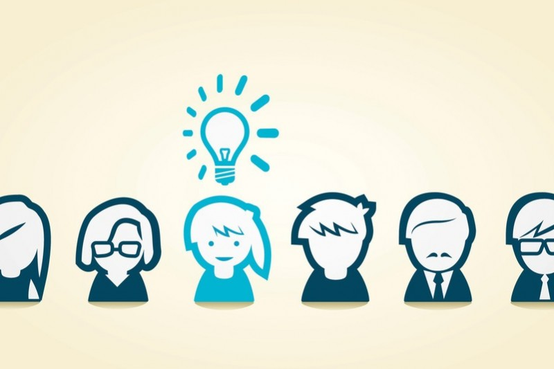 Cartoon with a group of people and an idea light bulb above one of them