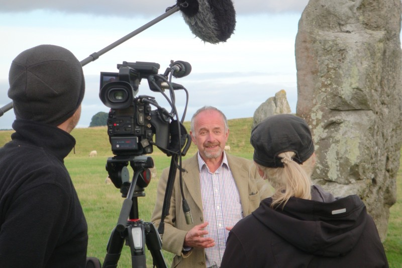 Timothy Darvill in front of the cameras at Avebury