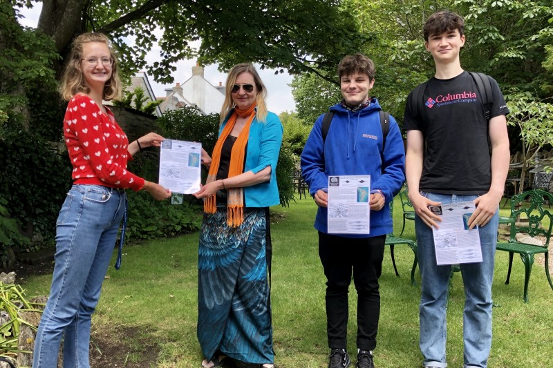 BU students hand over a factsheet to Portland Museum