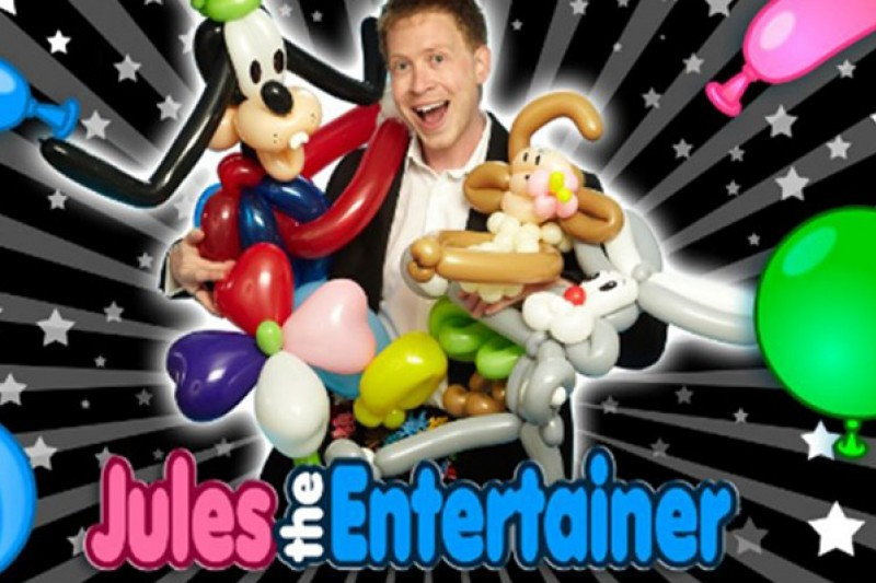 An image of Jules the Entertainer with show props