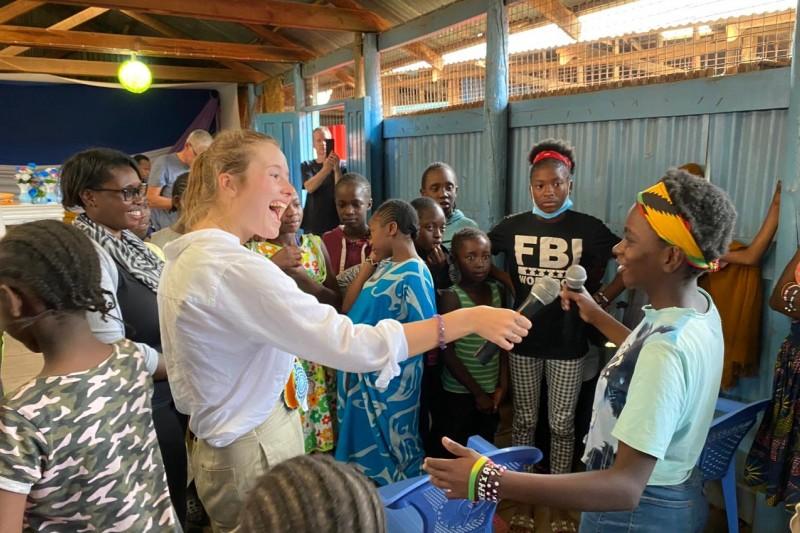 Ruth Harley, BU graduate, working with a group of girls in Kenya