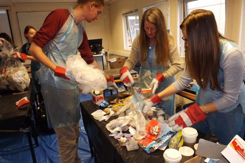 students sorting through waste