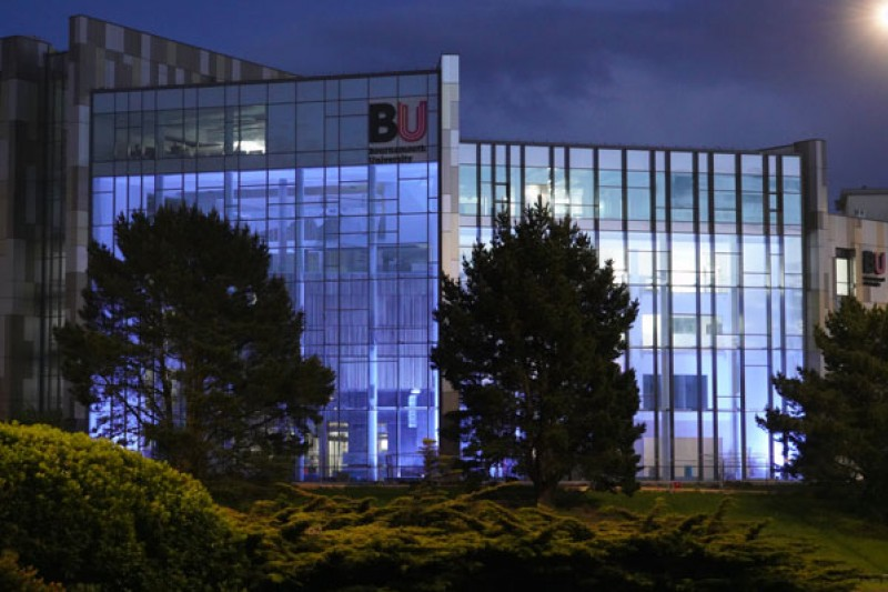 The Bournemouth Gateway Building, the new home of the Faculty of Health & Social Sciences, lit up blue on a #clapforcarers evening in support of the NHS