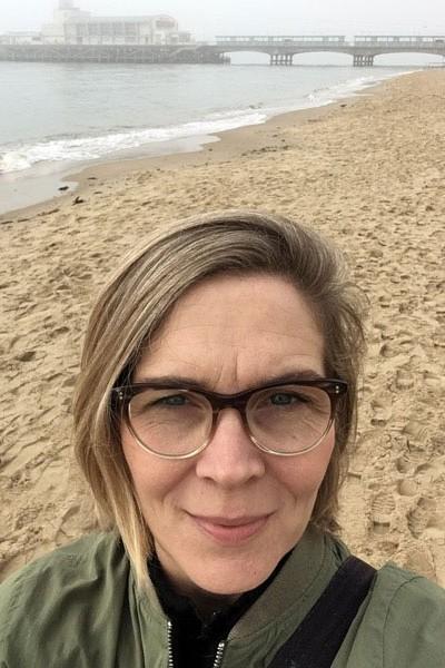 Emma Walters, EdD graduate, on Bournemouth beach