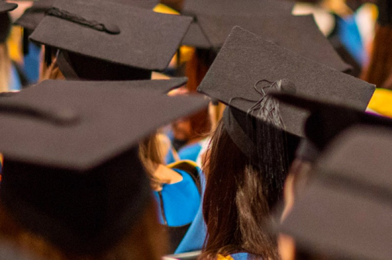 Students in the audience at a graduation ceremony