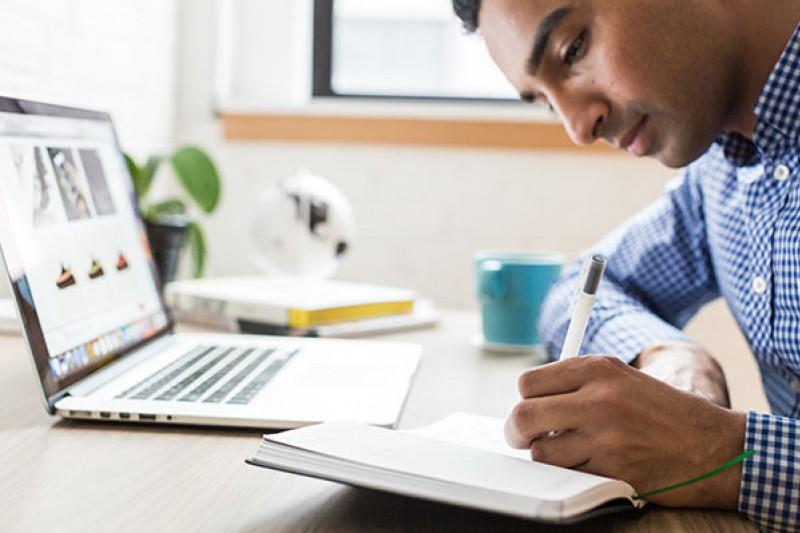 Interview prep - man writing at desk