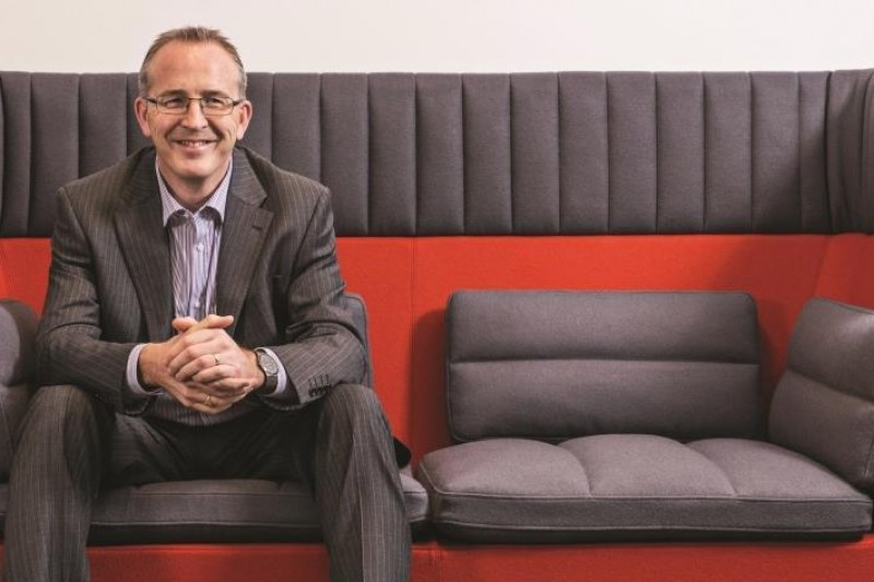 John Vinney sitting on a sofa in the Fusion Building