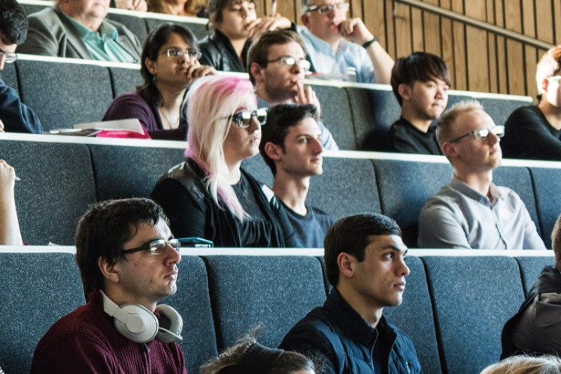 An audience in a lecture studio listening to a talk
