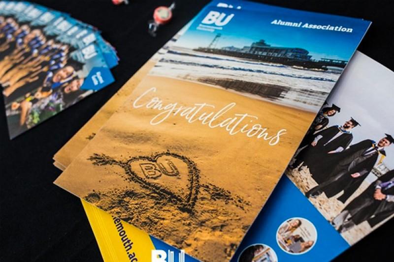 Booklets from the Alumni Association congratulating new graduates