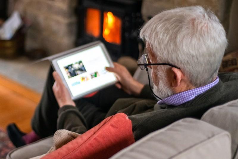 older man on tablet