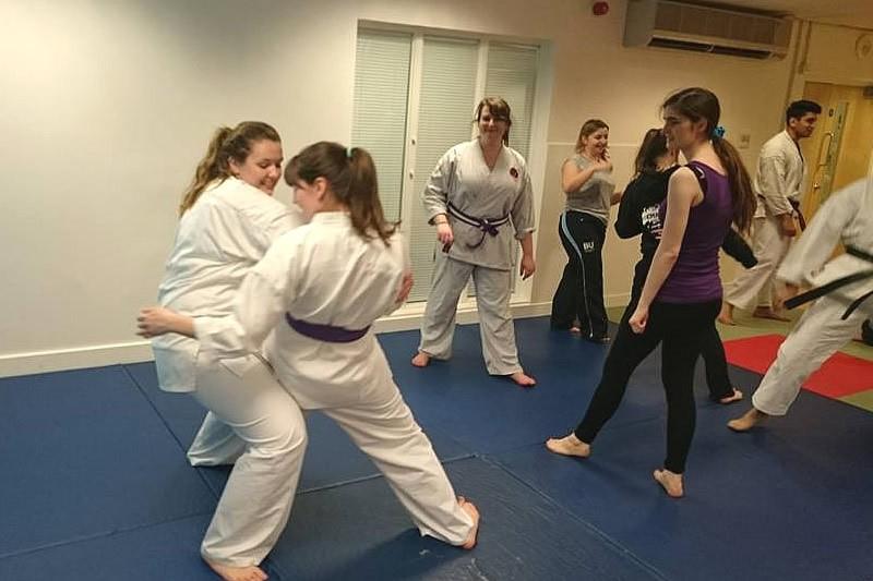 Two women taking part in karate