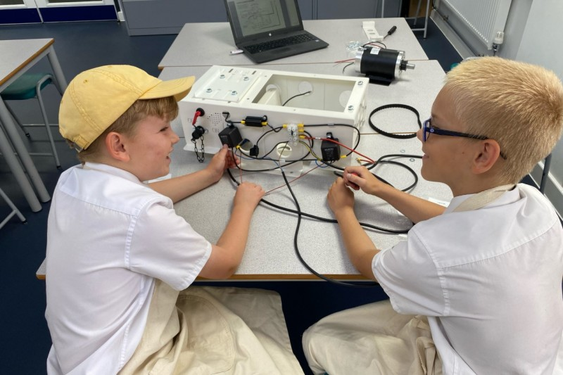 Pupils from St Peter's School work on an electric car
